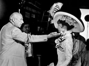 1964-production-designer-cecil-beaton-checks-audrey-hepburns-costume-on-the-set-of-my-fair-lady-19641